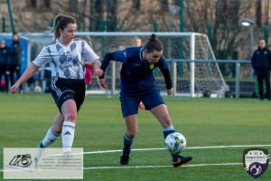 Kirsty MacDonald chases down the Partick Defender during the opening game of the Scottish Women's Premier League 2 Season Glasgow Girls FC vs Partick Thistle WFC at Petershill Park, Glasgow.
