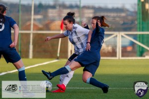 Lauren Ann Kerr shields the ball under pressure from Rebecca Bisland during the opening game of the Scottish Women's Premier League 2 Season Glasgow Girls FC vs Partick Thistle WFC at Petershill Park, Glasgow.