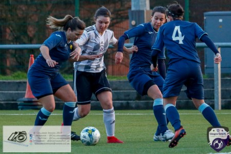 Eleanor Smith surrounded by Partick Thistle Players during  the opening game of the Scottish Women's Premier League 2 Season Glasgow Girls FC vs Partick Thistle WFC at Petershill Park, Glasgow.