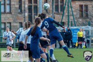 Taylor McGlashan heads the ball clear for the 1st corner of the game during the opening game of the Scottish Women's Premier League 2 Season Glasgow Girls FC vs Partick Thistle WFC at Petershill Park, Glasgow.