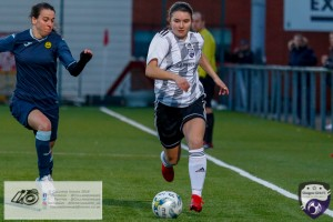 Eleanor Smith of Glasgow Girls FC heads towards goal during the opening game of the Scottish Women's Premier League 2 Season Glasgow Girls FC vs Partick Thistle WFC at Petershill Park, Glasgow.