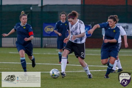 Georgie McTear tries to break out from the back during the opening game of the Scottish Women's Premier League 2 Season Glasgow Girls FC vs Partick Thistle WFC at Petershill Park, Glasgow.
