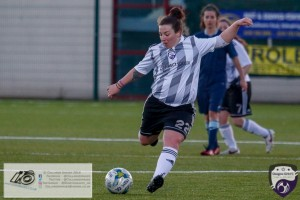 Kirsten McGuire clips a long ball into the corner during the opening game of the Scottish Women's Premier League 2 Season Glasgow Girls FC vs Partick Thistle WFC at Petershill Park, Glasgow.