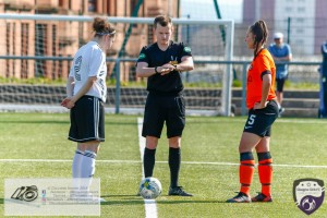 Captains Gorgina McLear (Glasgow Girls) & Keira Johnstone (Dundee Utd) meet on the halfway line for the coin toss Glasgow Girls FC Vs Dundee United FC at Petershill Park in Glasgow.