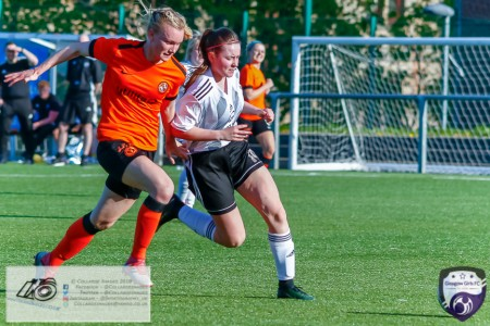 Glasgow Girls Jayny Leigh Saunders gets around the Dundee United defender while being held back during the Scottish Women's Premier League 2 fixture, Glasgow Girls FC Vs Dundee United FC at Petershill Park in Glasgow, Sunday 21st April 2019.